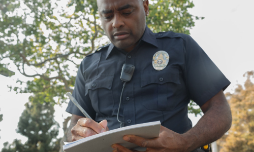 Police Officer Writing Notes