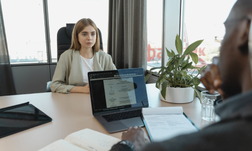Woman Interviewing for Job with Male Hiring Manager