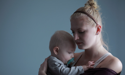 Blonde Woman Carrying Baby